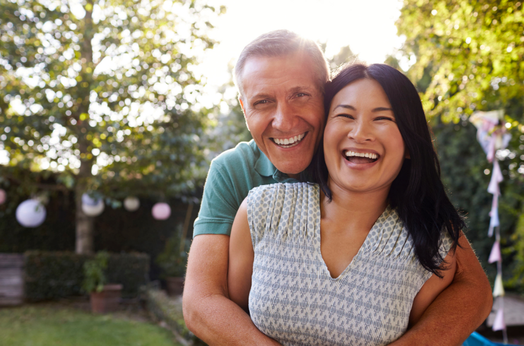 Leland Management Residents – Middle-Aged Couple Laughing and Hugging Outdoors